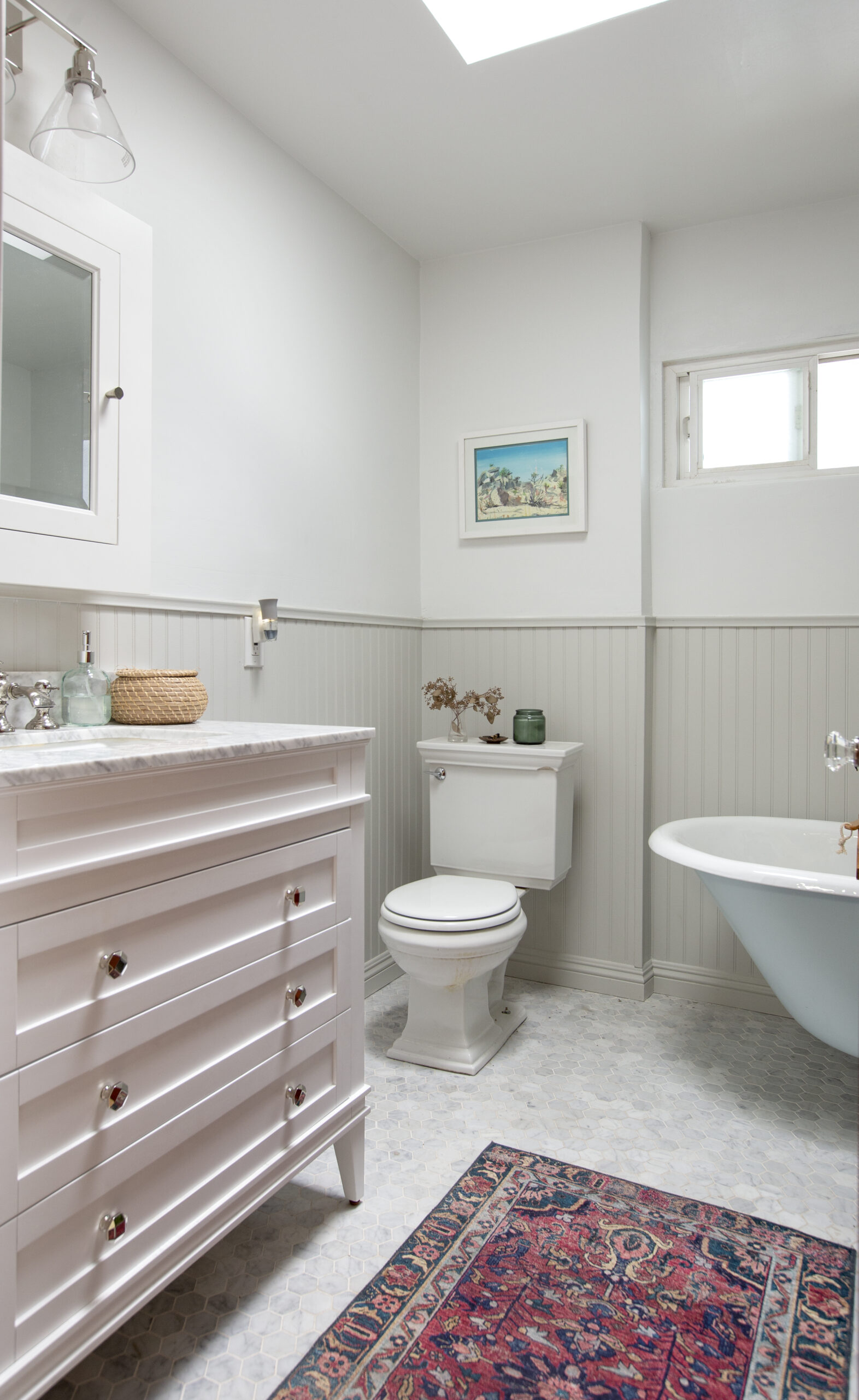 Gray and White marble bathroom with beadboard